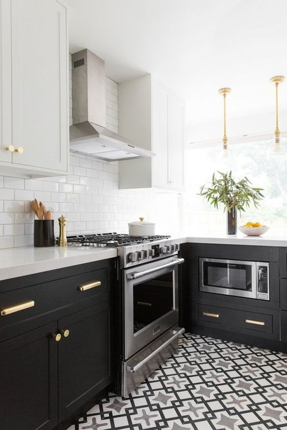 a black and grey L-shaped kitchen with a printed tile floor, a white subway tile backsplash and white stone countertops