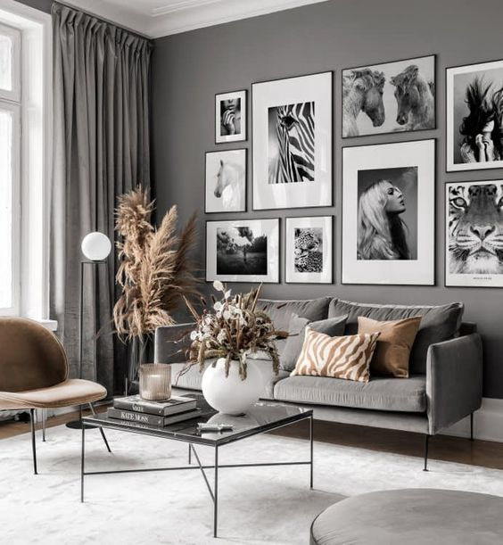 a black and white gallery wall with matching frames and black and white prints looks chic and elegant