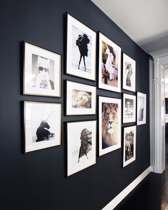 a bold and cool gallery wall with matching black frames and colored and black and white prints will add to the style