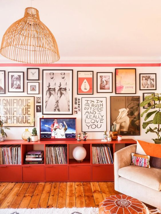 a bold gallery wall with colorful art in mismatching black frames will bring a touch of color and an artful feel
