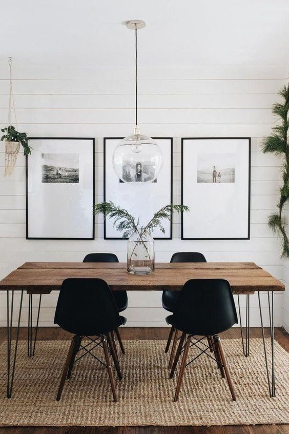 a bold grid gallery wall with thin black frames, a lot of matting and black and white photos placed in the top part