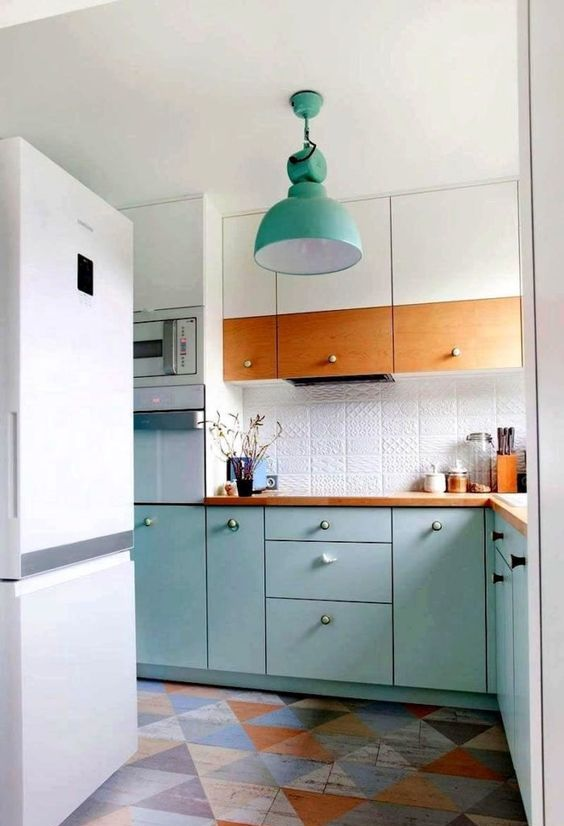 a bright Scandi kitchen in white and turquoise, with a patterned tile backsplash and stained wood