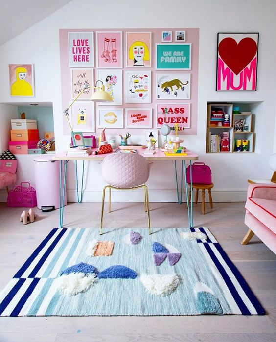a bright and fun gallery wall on a pink part of wall, bright artworks, posters and signs is a gorgeous and glam idea