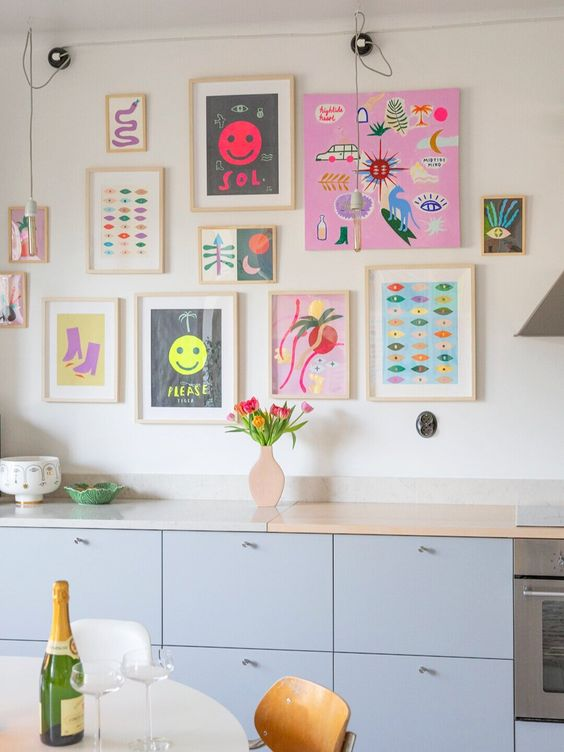 a bright and fun gallery wall with matching light stained frames and with no frames, with super bold artworks and posters