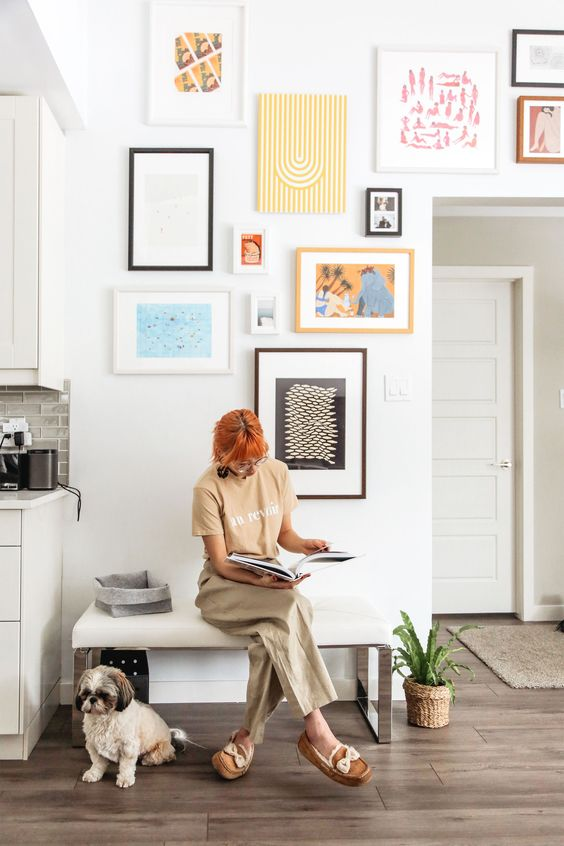 a bright and fun gallery wall with mismatching frames, shapes, sizes and artworks for a fun and eclectic touch