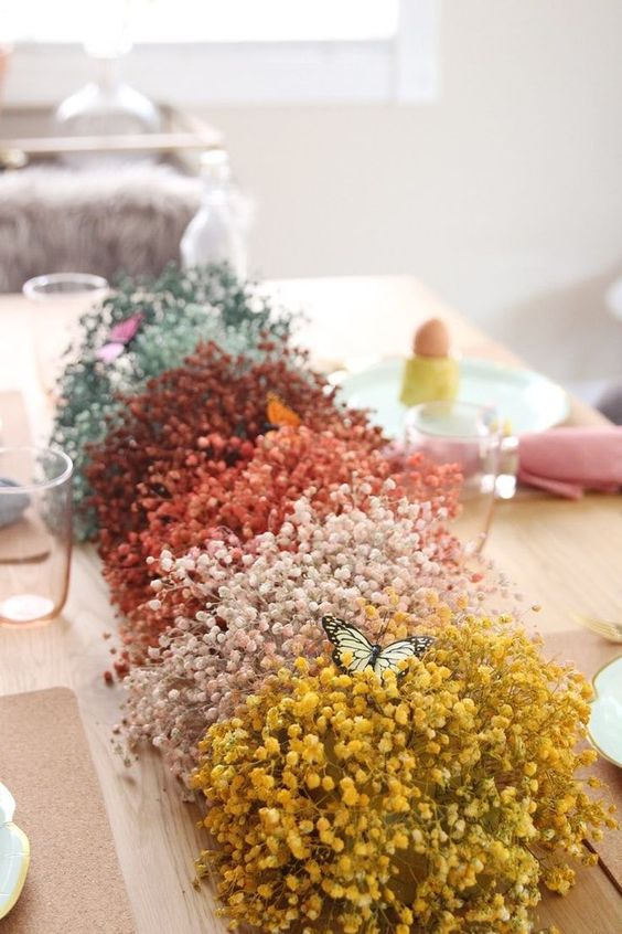 a bright baby's breath centerpeice with bold faux butterflies is a very fun and bold idea for spring and Easter