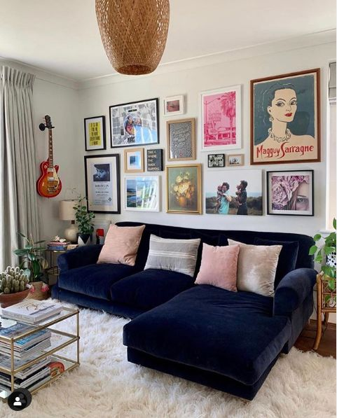 a bright gallery wall with mismatching frames and art of various types and sizes for an eclectic feel