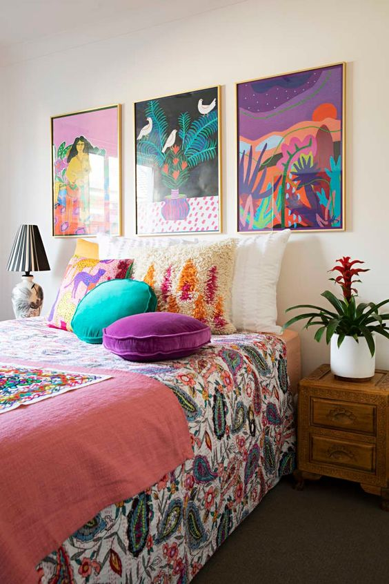 a cute bedroom with a grid gallery wall