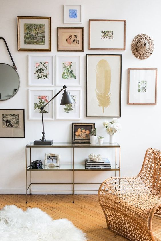 a chic gallery wall with thin frames and botanical theme as the main one feels very spring-like