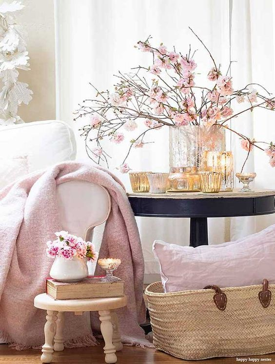 a chic vase with pink blooming branches and candles around is a beautiful idea for a spring tablescape or just your room