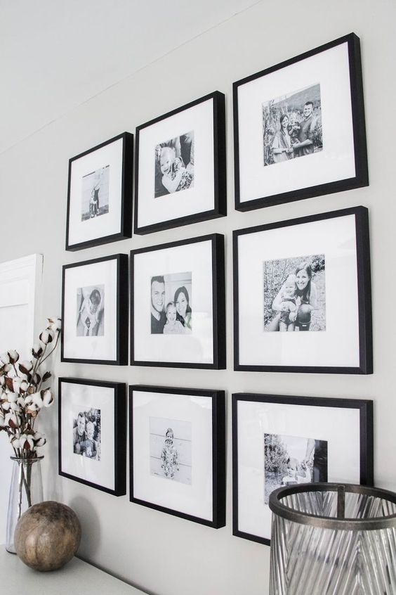 a classic grid gallery wall with black frames, white matting, black and white family pics is good for many interiors