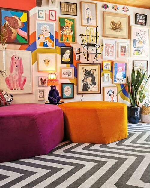a colorful and bold gallery wall with mismatching frames and super bold artworks in various styles placed on a wall with color block
