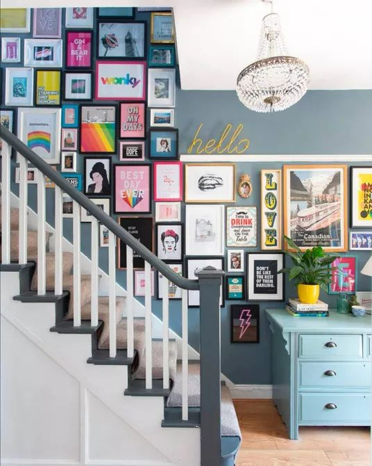 a cute stairway gallery wall in different colors