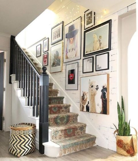 a colorful gallery wall with mismatching frames and colorful artworks is a stylish idea for a bold and fun eclectic space