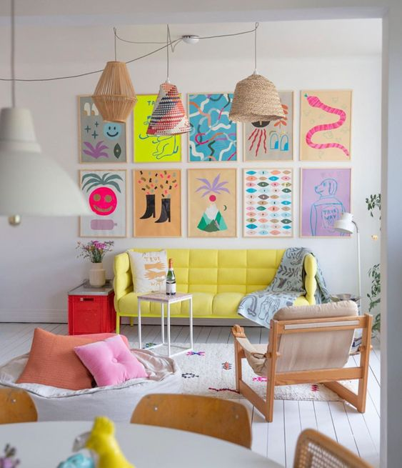 a colorful neon gallery wall with fun abstract and primitive posters will add a funky and bright touch to the space