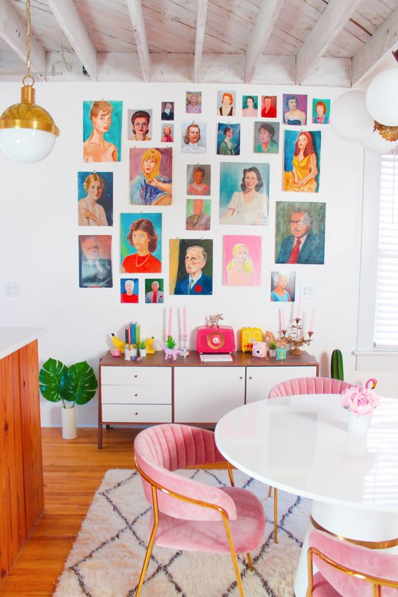 a colorful portrait gallery wall with no frames included will add personality and a bold touch to the space