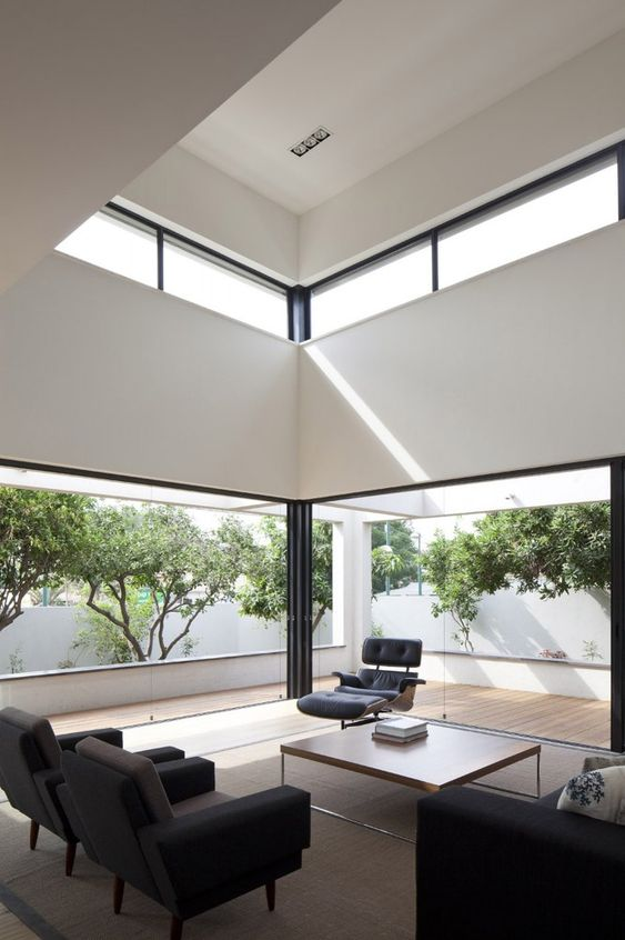 a contemporary black and white space with walls to remove and clerestory windows that bring more light to this double height ceiling space