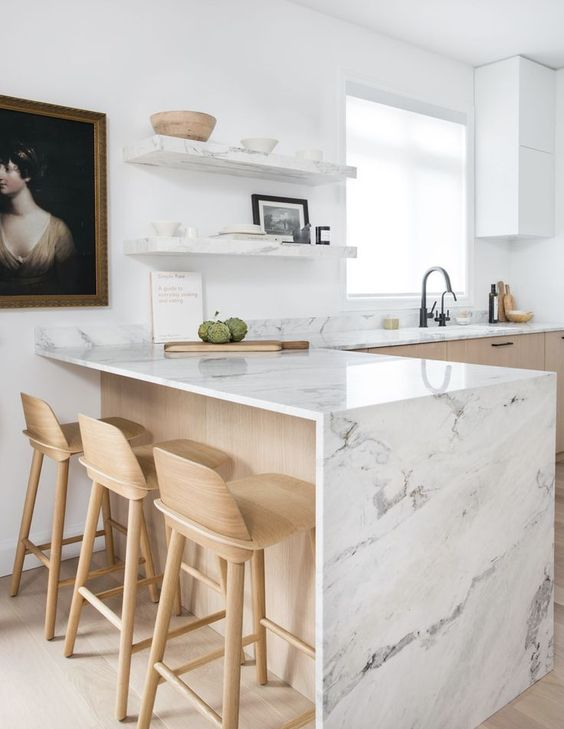 a contemporary blonde wood kitchen with white stone countertops and matching open shelves is a very fresh idea