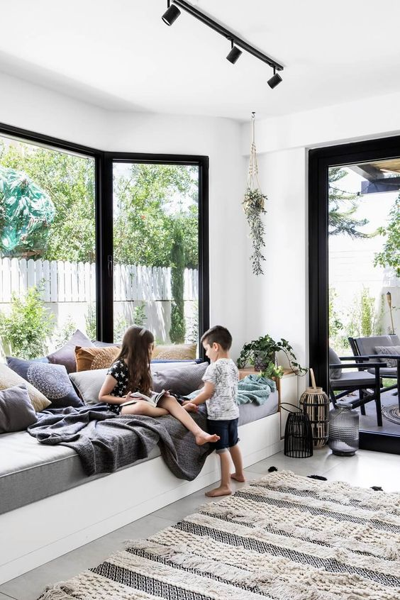 a contemporary space with a bow window and a large and soft daybed on the windowsill is an amazing space to relax