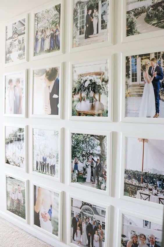 a cool grid gallery wall with white frames and no matting plus colored family pics is pure beauty