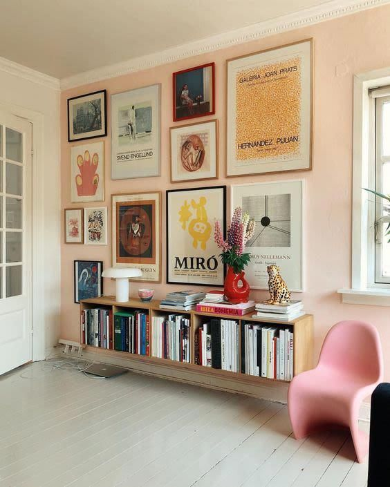 a cool pop art gallery wall with thin frames and various kinds of prints and artworks in bright colors is very catchy