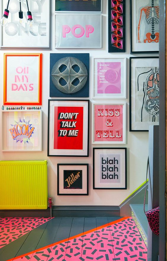 a crazy gallery wall with mismatching frames and all bold and fun art including posters and prints is a bold idea