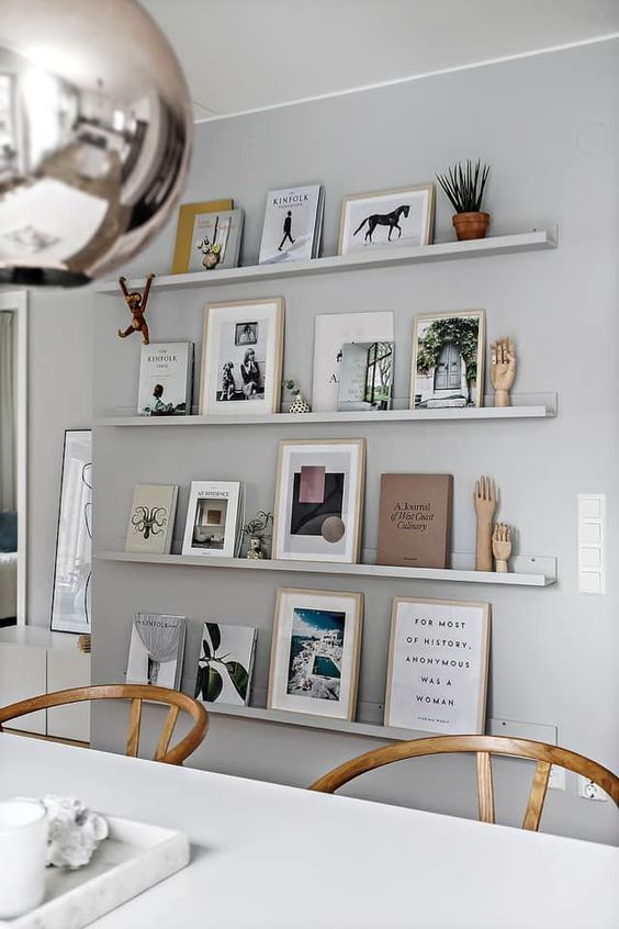 a dove grey wall with matching ledges that merge with the wall and make all the objects on display floating in the air