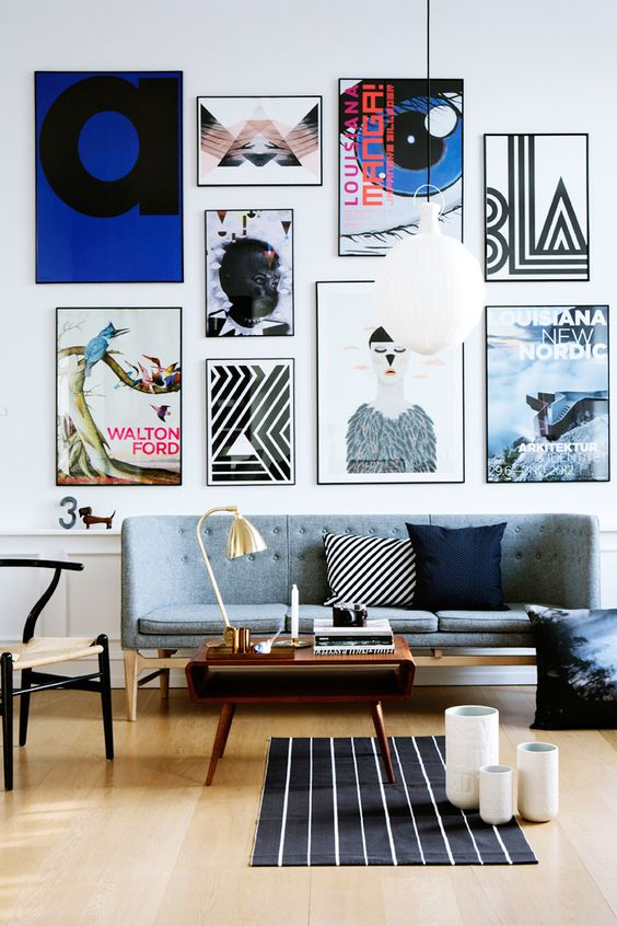 a fantastic free form gallery wall done with thin black frames and no matting looks very modern, fresh and edgy