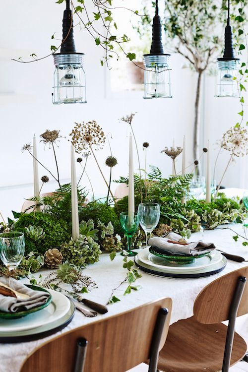 a fantastic woodland spring centerpiece of greenery, pinecones, dried flowers and grasses plus candles is fresh and cool