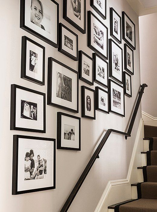 a free form gallery wall with mismatching black frames, black and white photos will refresh the space in a stylish way