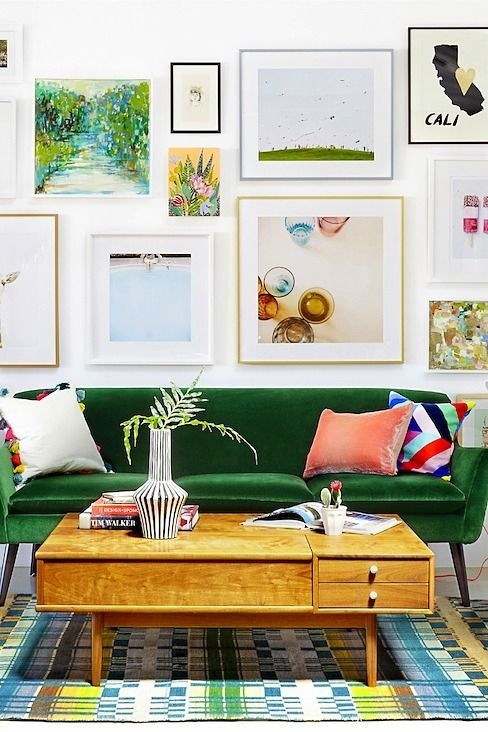 a gorgeous gallery wall in various colors, with mismatching frames and artworks and prints in bright shades