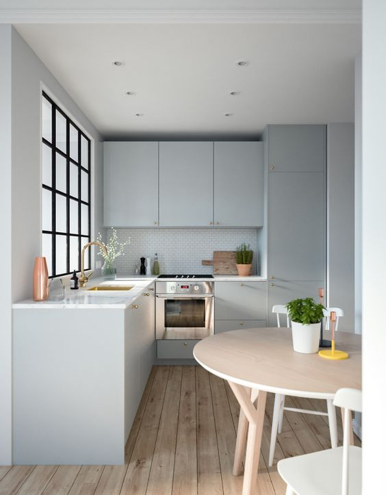 a grey contemporary kitchen with white stone countertops, a French frame window and a round table