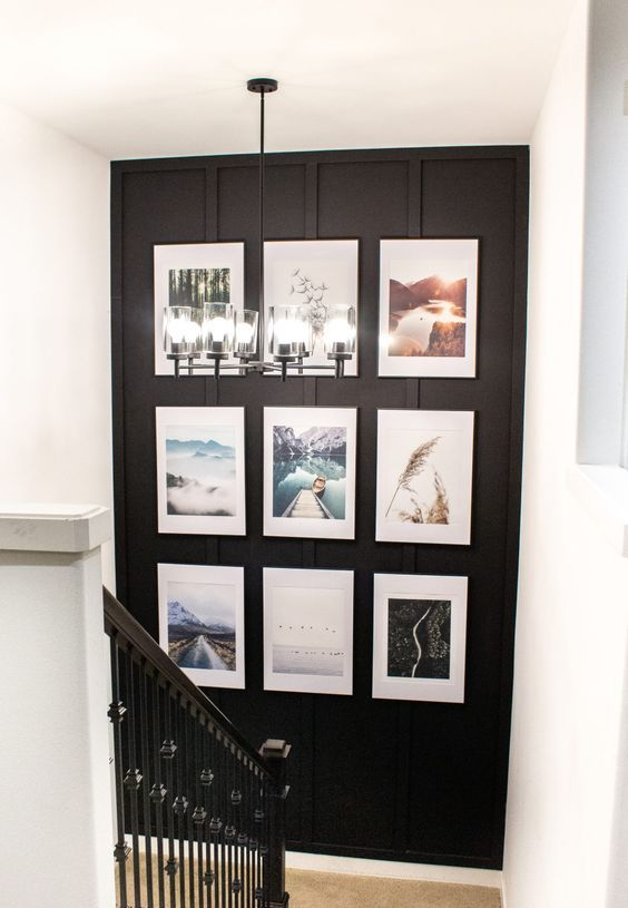 a grid gallery wall with matching black frames, colorful photos and white matting is an elegant modern way to style the space