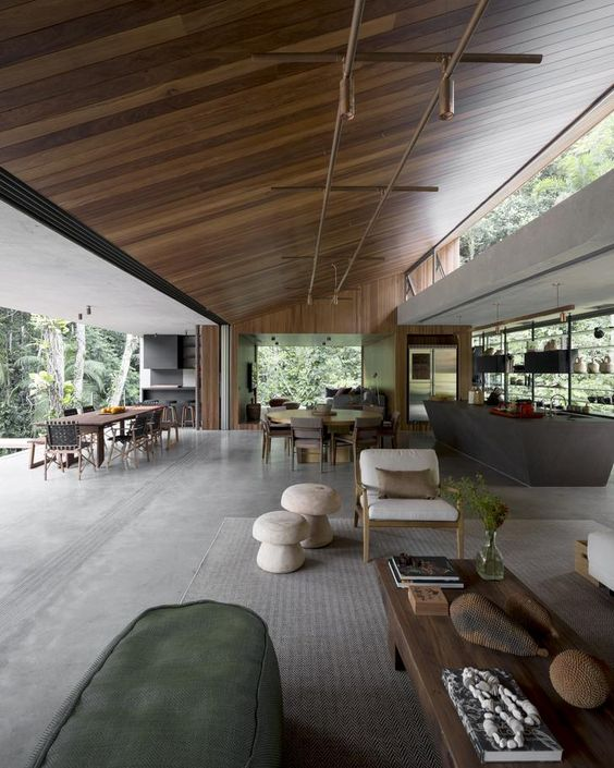 a large open space with a kitchen, dining room and a living room with a wall that cna be removed, a glass wall and clerestory windows