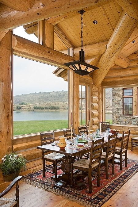 a log cabin with large windows to enjoy the views and clerestory windows for more light and a more modern feel