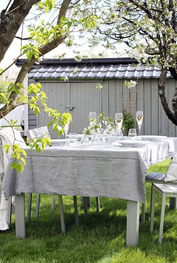 an outdoor dining zone in neutral shades