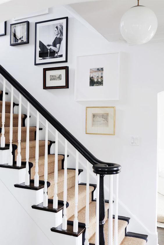 a lovely free form gallery wall with mismatching artworks and frames is a creative and fresh touch to the traditional space