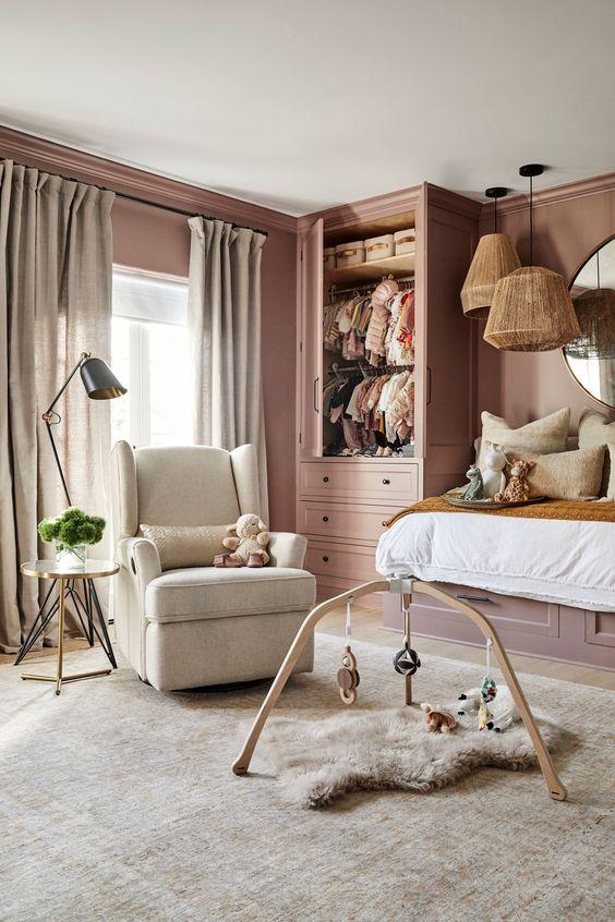 a mauve kid's room with a raised bed, a mobile and a chair, some pendant lamps is a chic place