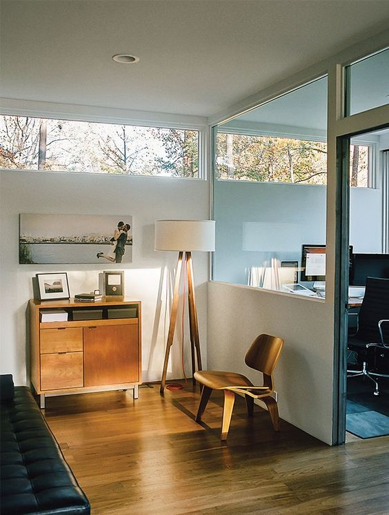 a mid-century modern space - a bedroom and a home office, with clerestory windows for more light and views
