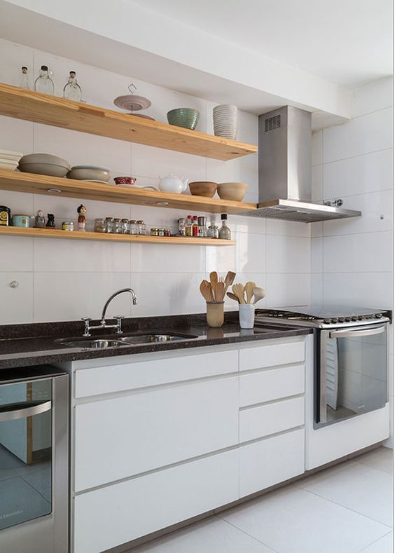 a minimalist white kitchen with black stone countertops and open shelves is a chic and elegant idea