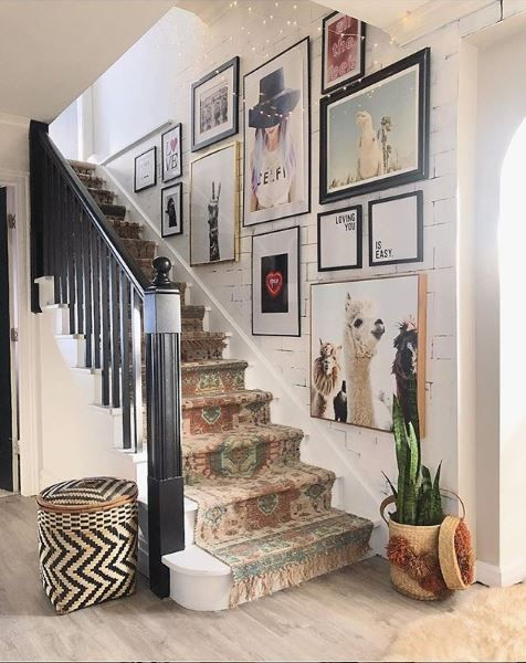 a modern and fun gallery wall with mismaching gold and black frames is a stylish idea to add a fresh feel to the house