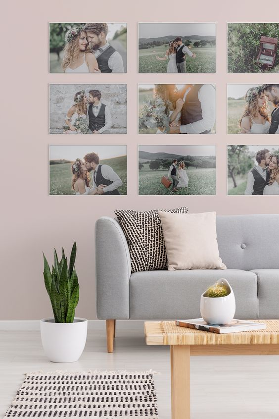 a modern gallery wall with super thin white frames, no matting and colorful family pics is a fresh idea