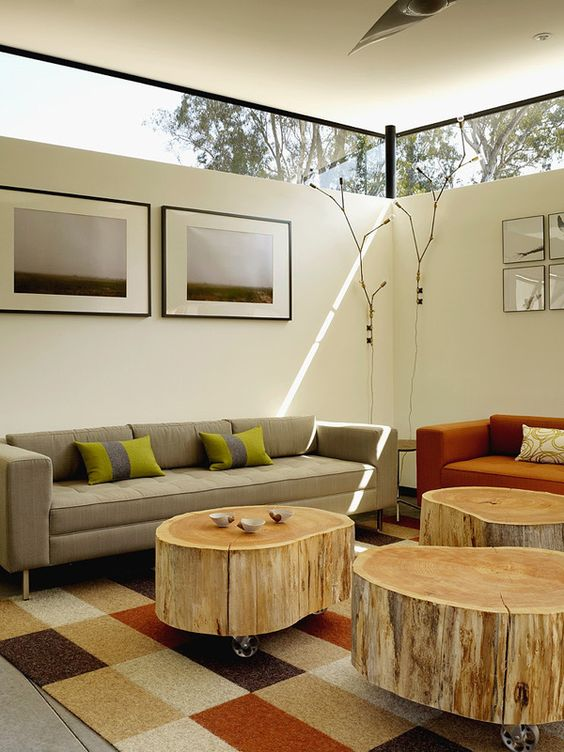 a modern living room with chic furniture and tree stump coffee tables plus clerestory windows for light yet privacy