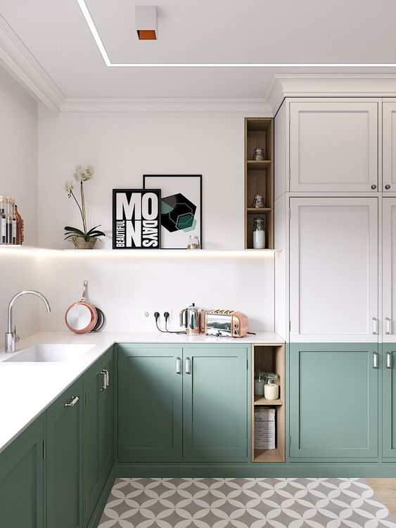 a modern two-tone L-shaped kitchen with built-in light and white stone countertops is a chic space