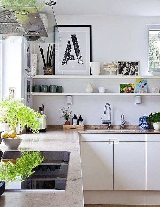 a neutral L shaped kitchen, open shelves, greenery and stone countertops plus windows for natural light