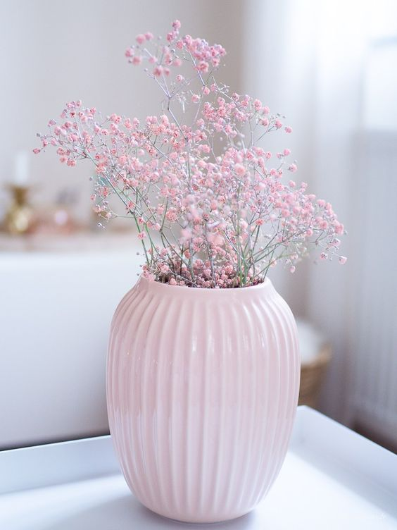 a pastel pink vase with pink baby's breath is a very beautiful spring decoration and centerpiece in one
