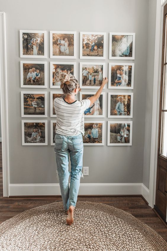 a pretty Polaroid-inspried grid gallery wall with thick white frames, no matting and colorful family photos is a fresh take on traditional gallery walls