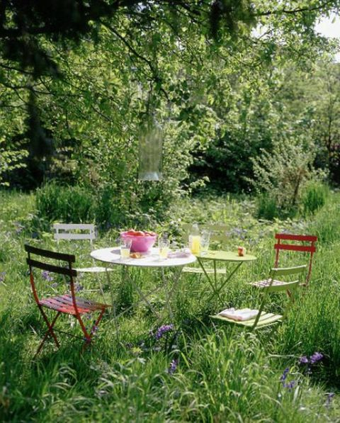 a pretty and light eating space with round tables and bright and pastel chairs is easy to compose anytime