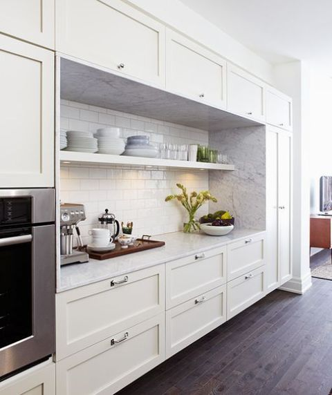 a pretty farmhouse one wall kitchen in white, with a white stone and subway tile backsplash is a cool idea