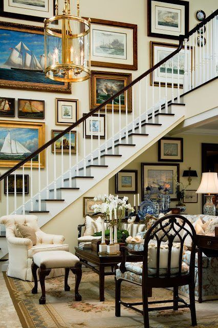 a refined and chic vintage gallery wall with mismatching frames and paintings and prints is a lovely idea for a staircase